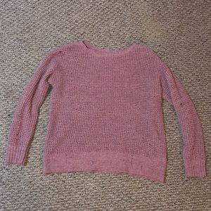 Very soft sweater with intentional holes